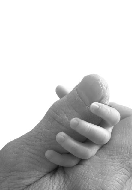 Baby Holding Mans Finger