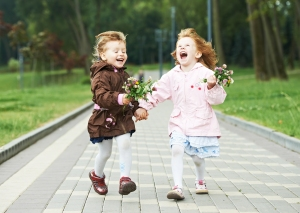 two happy little girls kids having fun while and laughing runnin