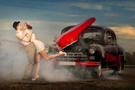 Young couple  next retro car  in smoke